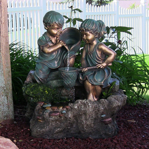 Boy and Girl Playing in Water Outdoor Water Fountain with LED Light - ZenWaterFountains.com  - 1