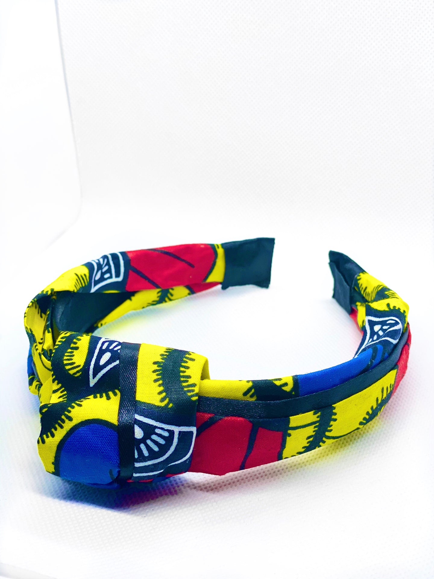 Pull back your tresses in the chicest way in our handmade African print knot headband