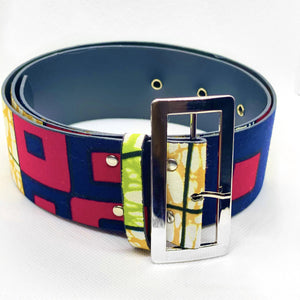 This statement handmade African print belt features a large silver hardware buckle that can be paired with any outfit of your choosing.