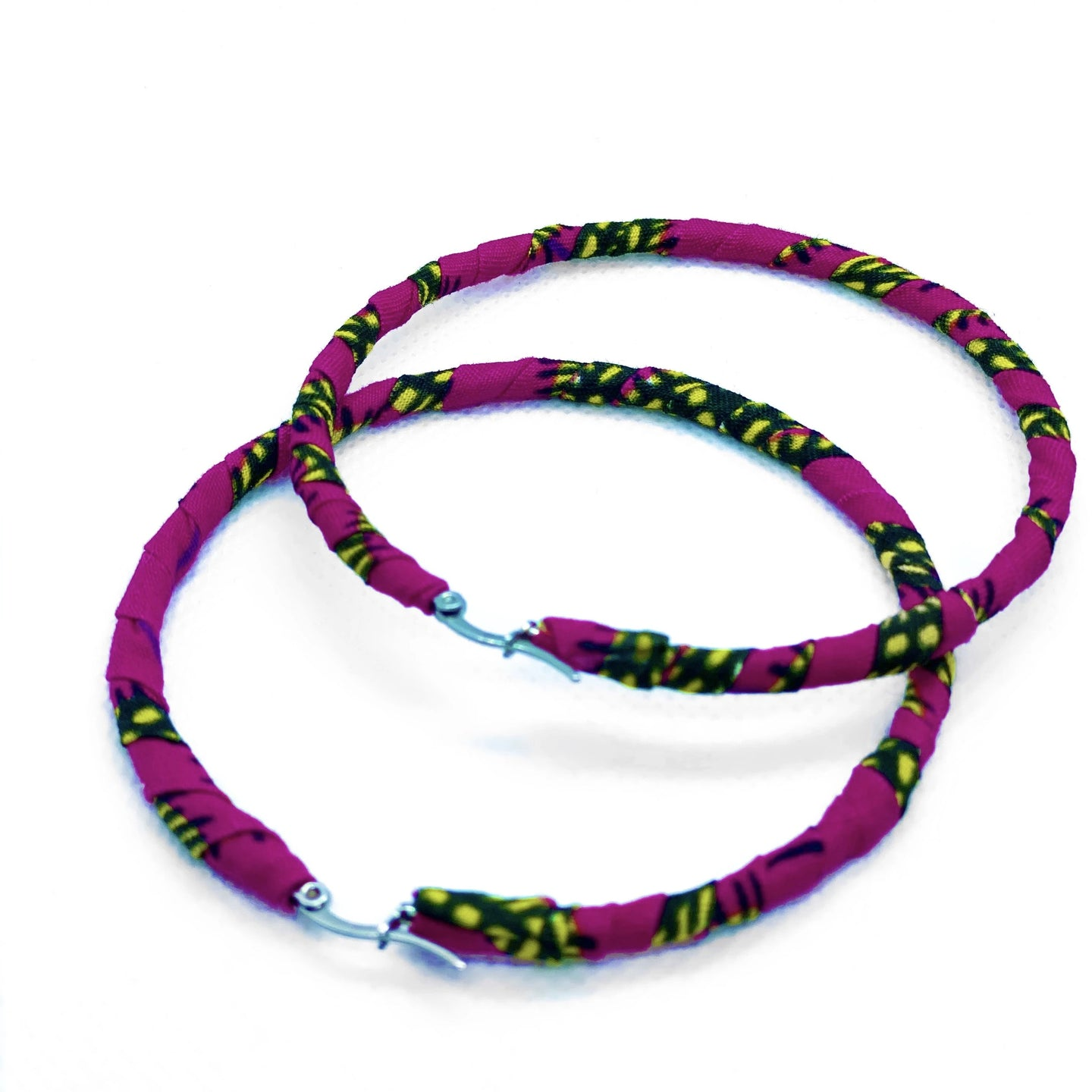 Handmade African Print hoop earrings. This classic hoop earrings with a modern african twist is perfect for both day and night time style.