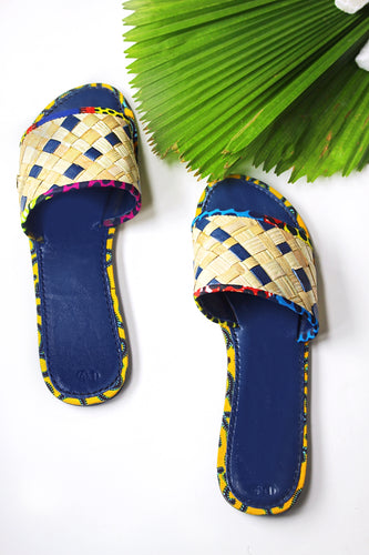 Handmade woven rattan, leather and african print slides. Vacation ready, summer perfect!