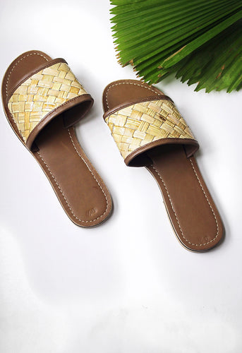 Handmade woven rattan and leather slides. Vacation ready, summer perfect!