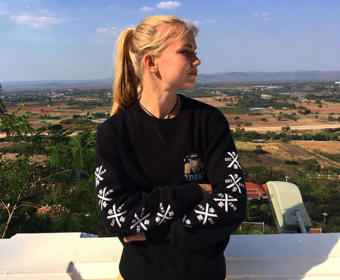 Marie Ruumet wearing the EST Yorky MMA Sweater Marie Ruumet edition on a upcountry balcony