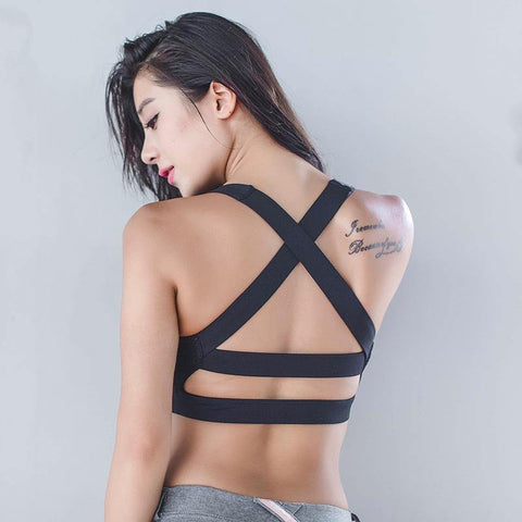 Woman Sport Top Bra with open straps backside black wear by model back view