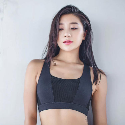 Woman Sport Top Bra with open straps backside black color wear by model front view