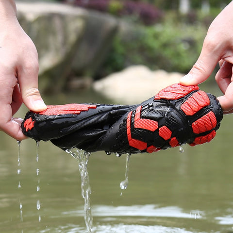 water shoe being twisted with water dripping out