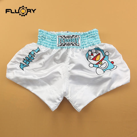 white and light blue muay thai shorts for kids with Doraemon cartoon character embroidered on the side