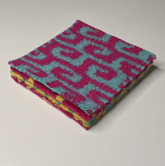 Stack of knitted felted coasters
