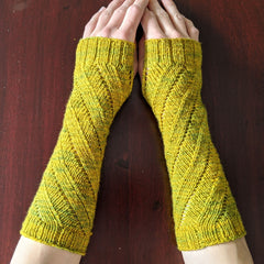 Pair of wristwarmers worn on hands, knit in fingering yarn
