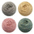 4 cakes of naturally dyed yarn in grey, cream, pink and green