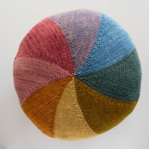 Colourwheel cushion using hand dyed DK weight 100% pure merino wool yarn with natural dye.