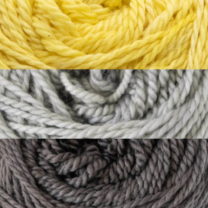 Close up of three colours of yarn, FlashDance, SilverStar and Tornado.