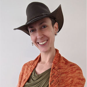 Person wearing cowboy hat and shawl