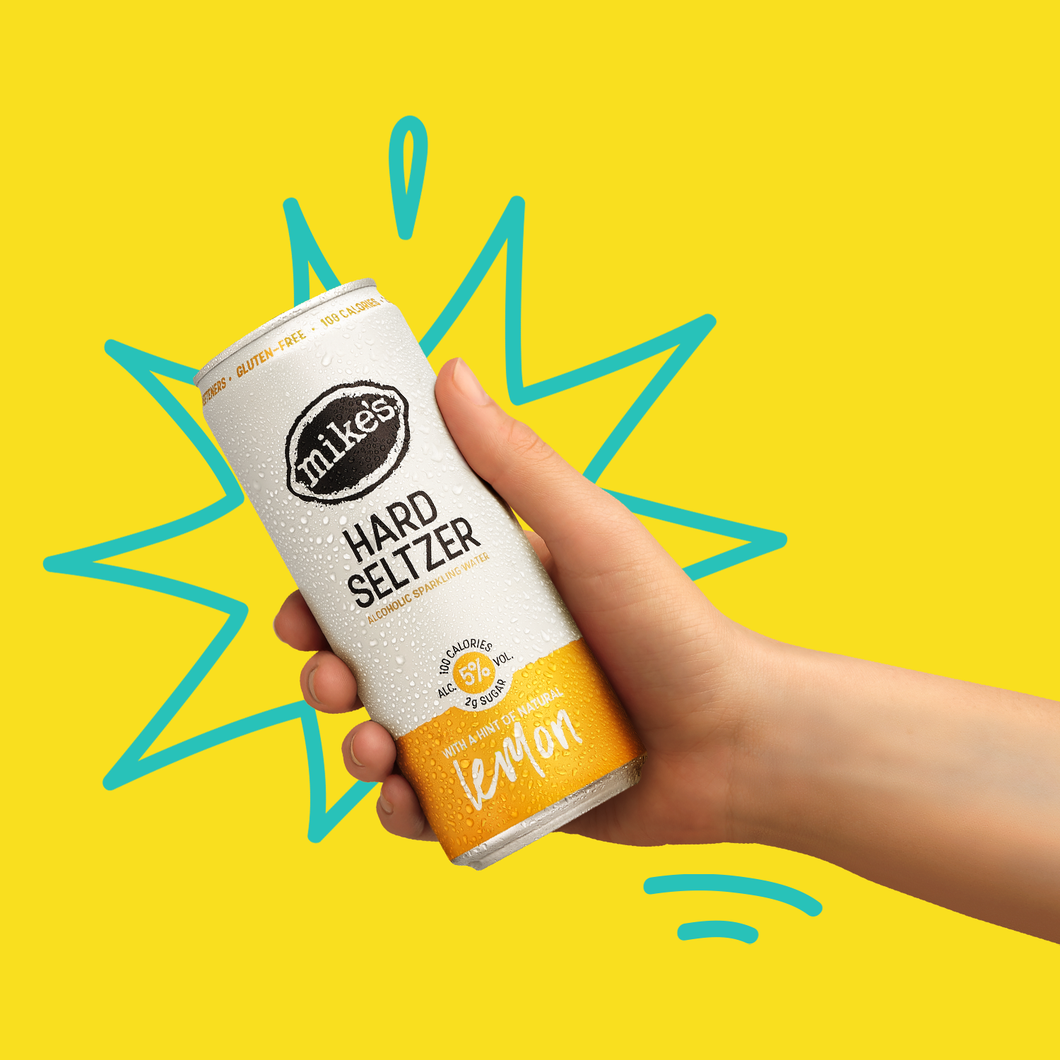 Lemon Hard Seltzer Can in Hand - Mike's Hard Seltzer