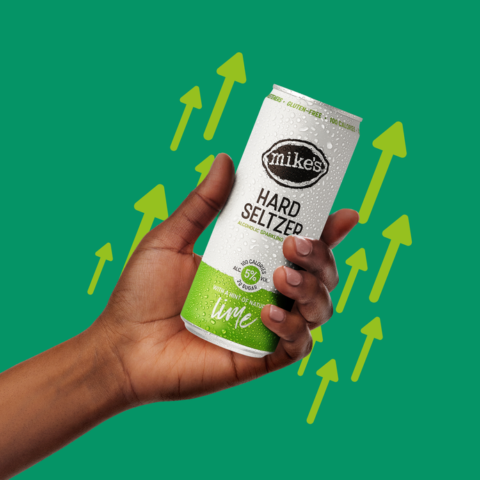 Lime Hard Seltzer Can in Hand - Mike's Hard Seltzer