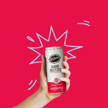Load image into Gallery viewer, Hand holding Mike's Hard Raspberry Hard Seltzer Can