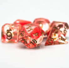 Load image into Gallery viewer, Faerie Skulls Encased in Blood Resin Polyhedral Dice Set for Dungeons & Dragons