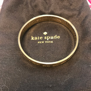 Primary Photo - BRAND: KATE SPADE STYLE: BRACELET COLOR: GOLD OTHER INFO: DOROTHY PARKER QUOTE LUXURIES/NECESSITIES SKU: 132-13288-19349