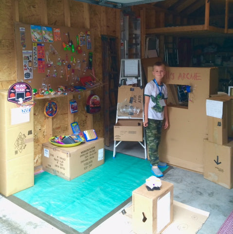 Will standing in front of his cardboard arcade.