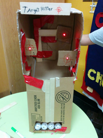 Target Hitter. A cardboard arcade game with an automatic ball return and light up targets.