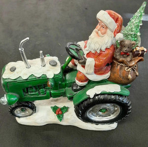 Santa on Tractor with Lightup Tree