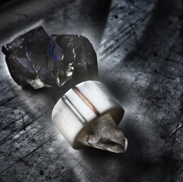 Contemporary, bone ring with silver and copper.