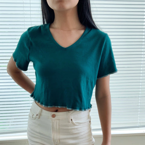 emerald crop top with white detailing