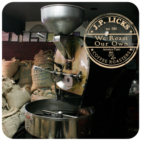 coffee bags of raw beans and a coffee roaster with JP Licks Roasters logo