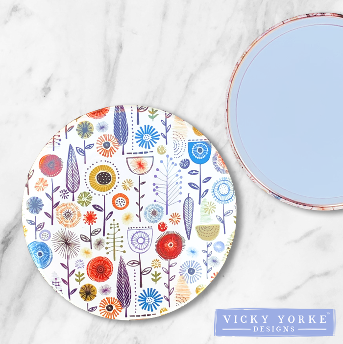 compact-mirror-flowers-woodland