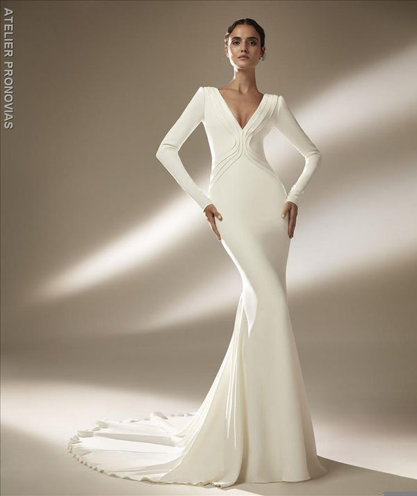Mermaid wedding dress with V-neck and long sleeves in crepe
