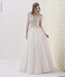 Wedding dress in embroidered tulle fabric with A-line cut