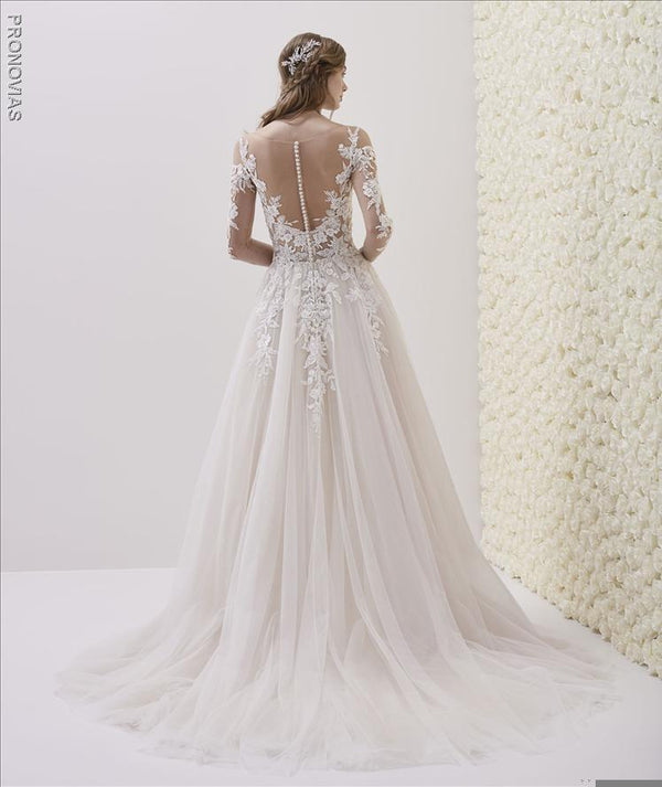 Wedding dress in embroidered tulle fabric with A-line cut  illusion back