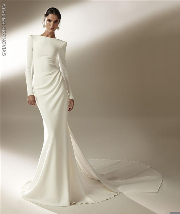 Mermaid wedding dress with bateau neckline and long sleeves in crepe