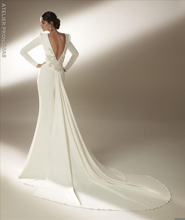 Mermaid wedding dress with bateau neckline and long sleeves in crepe back embroidery