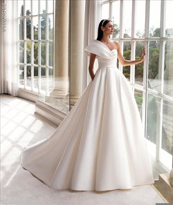 Pronovias Sedna  dress with princess cut asymmetrical neckline and cap sleeves