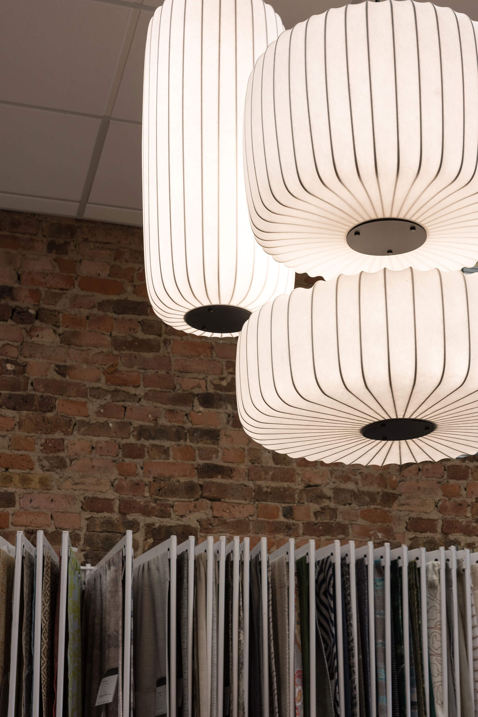 To, Te and M Pendant Lights in front of fabric samples