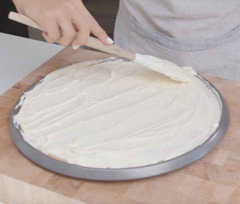 spreading frosting on a cake