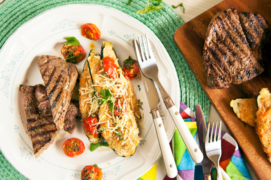 6. Steak served with garlic-Parmesan stuffed courgettes and grilled balsamic tomatoes