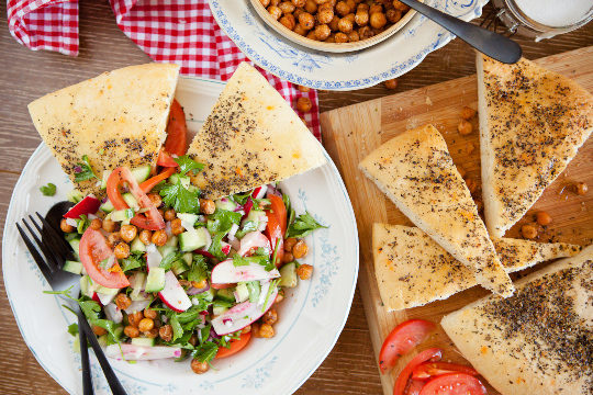 9. Spiced chickpea and salad bowl served with herby focaccia and yoghurt dressing