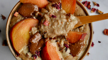 Salted Caramel Porridge topped with Peach, Tahini, Dried Rose Petals and Orange Push Chocolate