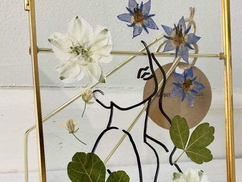 Artwork with picture frame and real pressed flowers inside