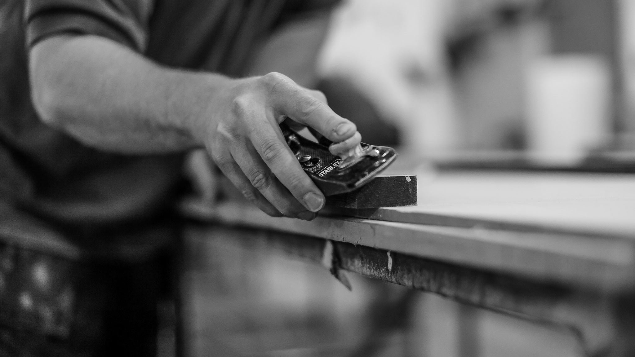 Hand made furniture - carpenter with Stanley wood plane