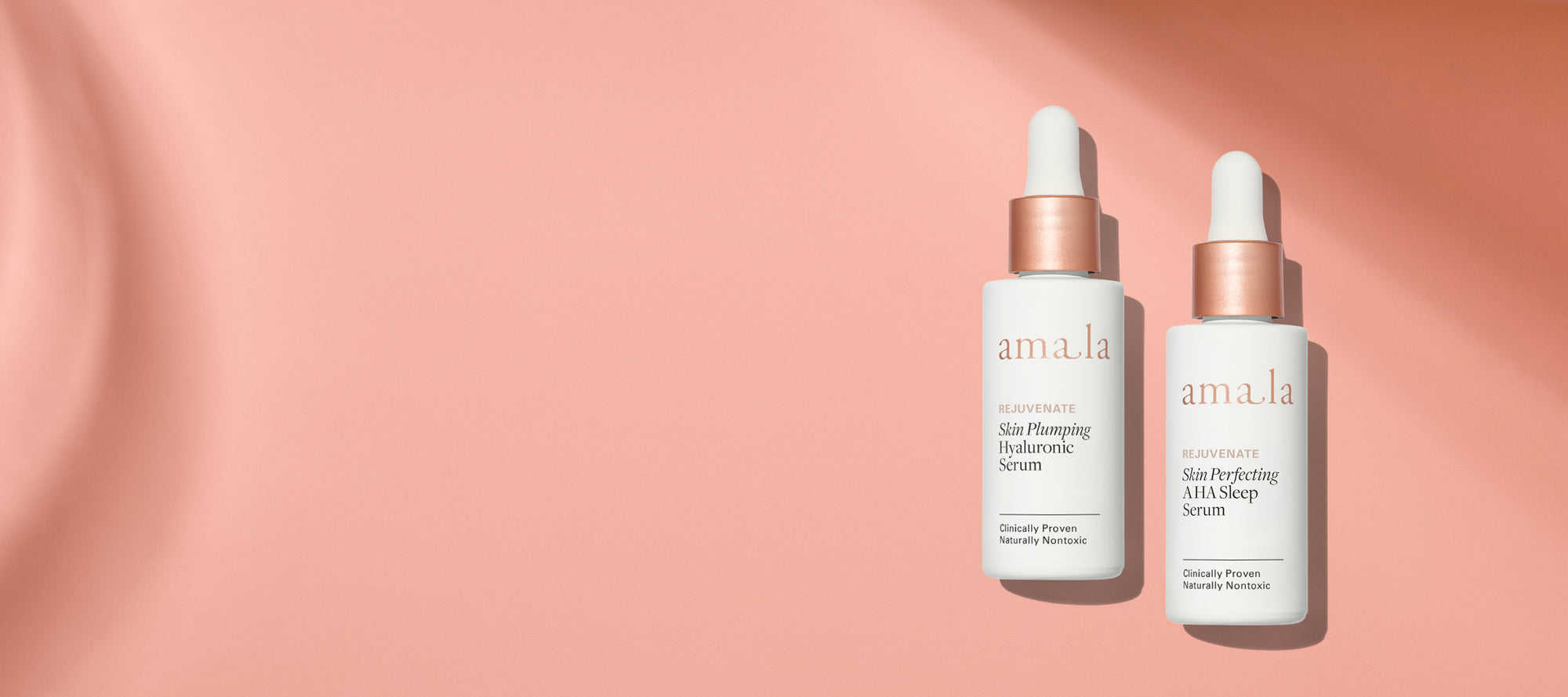 Immerse Your Skin: Amala Skin Plumping Hyaluronic Serum & Skin Perfecting AHA Sleep Serum on colored, textured background