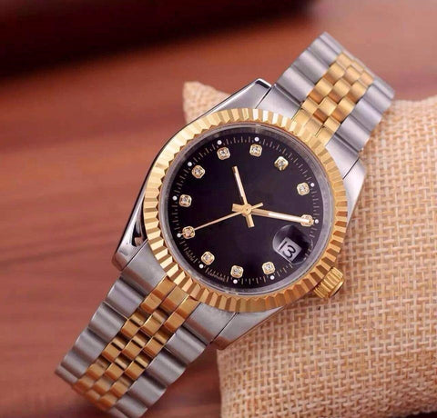 rolex watch on wrist with black dial