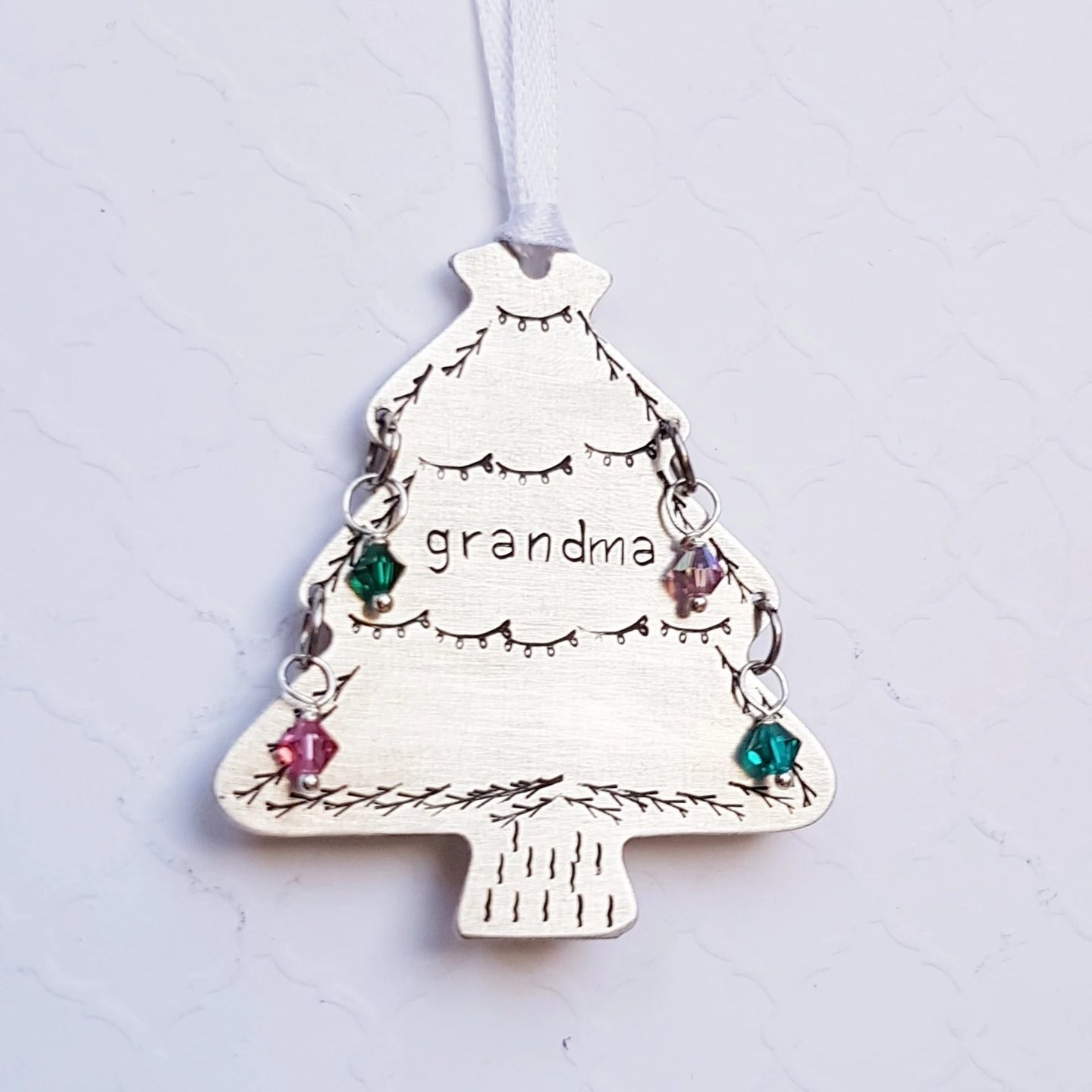stamped christmas tree ornament for grandma with grandchildren's birthstones