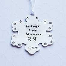 "Load image into Gallery viewer, ""baby's first christmas"" snowflake-shaped christmas ornament with baby's name, birth year, and tiny footprint stamps"