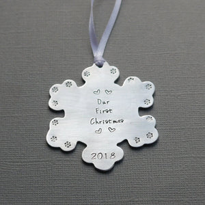 """our first christmas"" snowflake-shaped christmas ornament with tiny hearts and year"