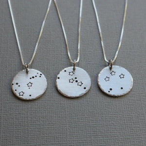 zodiac constellation stamped silver disc necklace
