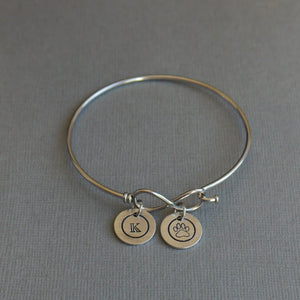 infinity bangle bracelet with stamped initial charms