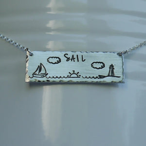 Silver bar necklace with sailboat, sunrise, and lighthouse